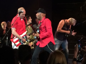 Wayne Kramer and Tom Morello on guitars, Tim Robbins on tambourine. Photo by Evelyn McDonnell.